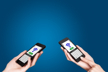 Two mobile phones with NFC payment technology  Near field communication photo