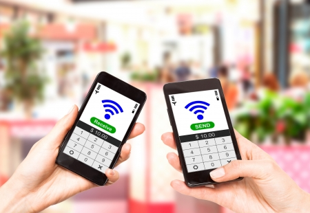 Two mobile phones with NFC payment technology  Near field communication Stock Photo - 20020503