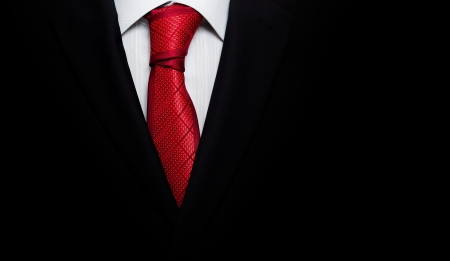 coat and tie: Black business suit with a tie