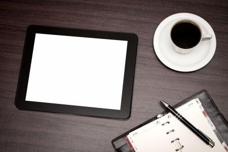 empty tablet and a cup of coffee on the desk Stock Photo - 20232345