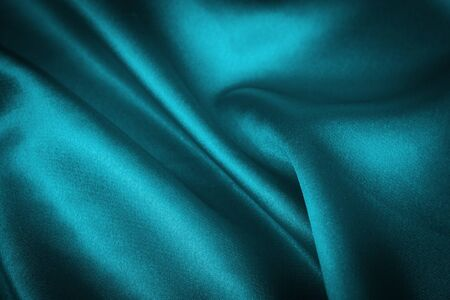 luxurious blue satin background closse up photo