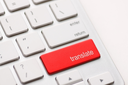 translate: Translate Computer Key In red Showing Online Translator Stock Photo