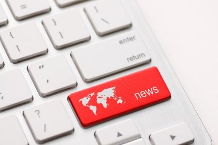 A news key button on laptop white keyboard photo