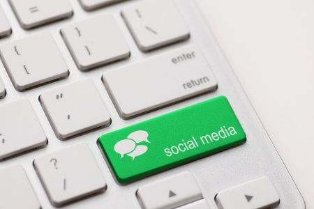 Social Media button on a keyboard with speech bubbles. Stock Photo - 20401102