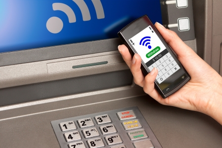 withdrawing: withdrawing money from atm with a mobile phone a NFC terminal