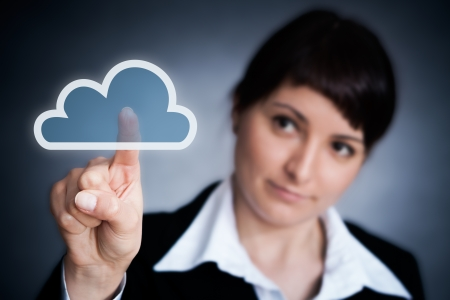 Cloud computing concept  Woman hand click on cloud icon photo
