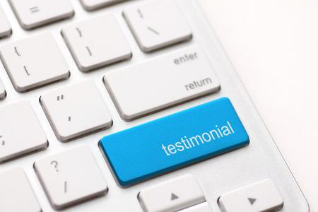 credentials: Testimonial button key on white keyboard