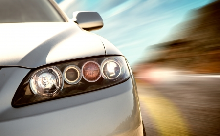 headlights: A car driving on a motorway at high speeds, overtaking other cars Stock Photo
