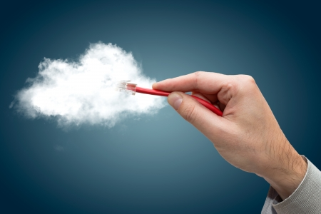 Cloud computing concept  Hand with ethernet cable connecting into cloud