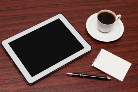 electronic book: empty tablet and a cup of coffee on the desk