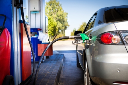 fuel economy: Car refueling on a petrol station