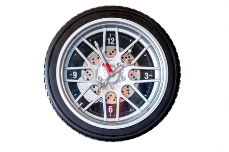 tyre tread: Isolated tire wall clock with analog time keeping