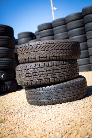 Stack of new tires for sale at a tire store  photo