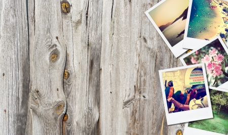 Frame with old paper and photos  Objects over wooden planks  photo