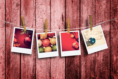 Photos frames on rustic red wood background  Christmas concept