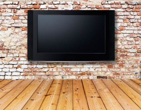 old television: interior with a television set on an old wall Stock Photo