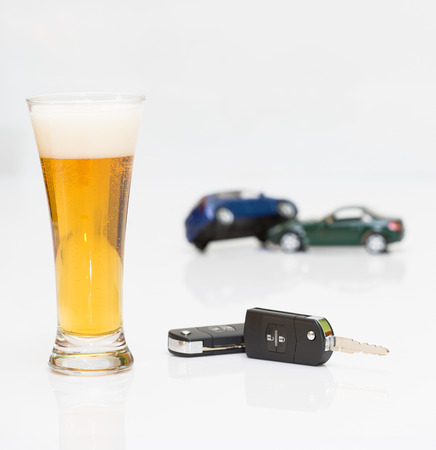 hard drive crash: glass of alcohol and car keys  Photo isolated on white background