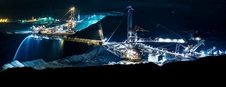 trencher: Coal mining in an open pit - evening photo