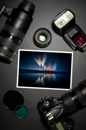 color digital camera: camera and lense on black showing photographer still life
