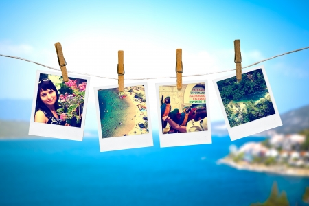 photos of holiday people hanging on clothesline with sea background photo