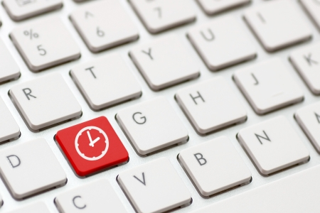 Computer keyboard with Clock icon on enter button background photo