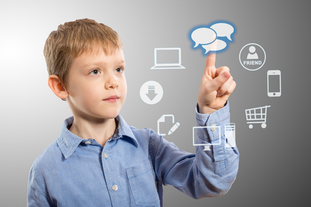 accessing: Boy accessing futuristic entertainment applications from the cloud computing interface Stock Photo