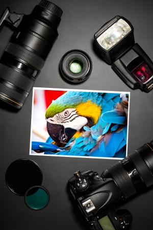 camera and lense on black showing photographer still life  photo