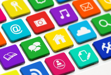 multimedia icons: Modern keyboard with colored buttons and social media symbols