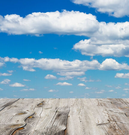 blue sky with clouds and wood planks floor  photo