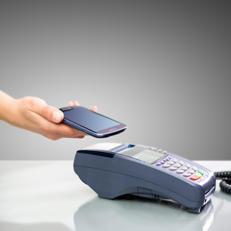 NFC - Near field communication, mobile payment Stock Photo - 24984732