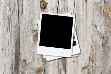Blank instant photo frames on old wooden  photo