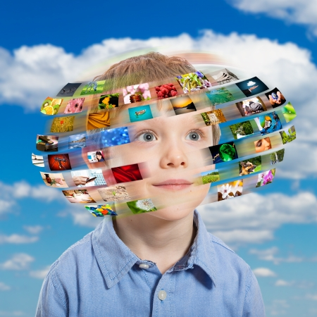A young boy has different media images around his head  photo