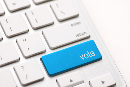 democracy concept with vote button on keyboard Stok Fotoğraf