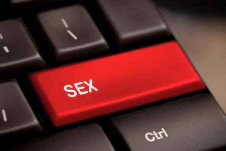 ソフト フォーカスとキーボード上のセックス ボタン 写真素材