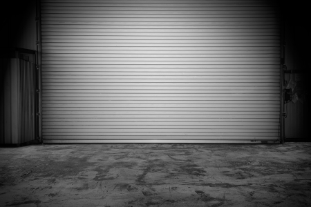Building made of concrete with roller shutter door photo