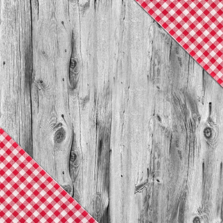 White and red tablecloth textile texture on wooden table background photo