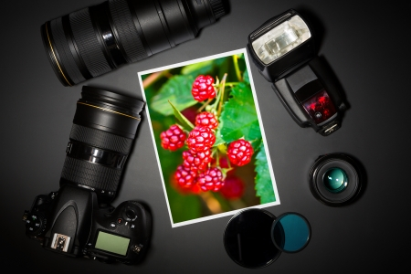 microstock: camera and lense on black showing photographer still life