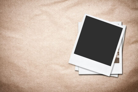 Blank instant photo frames on old paper background  photo
