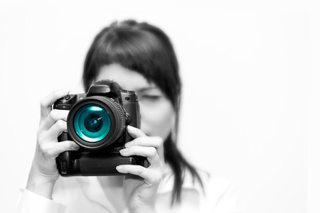 Pretty woman is a professional photographer with dslr camera photo