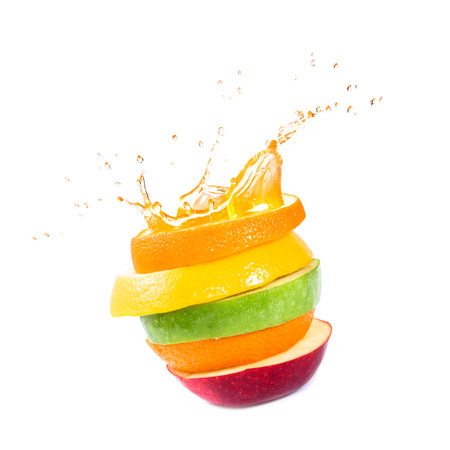 various type of fruit slices stacked with splash photo