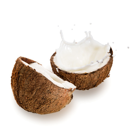 coco: Coconuts with milk splash on white background  Stock Photo