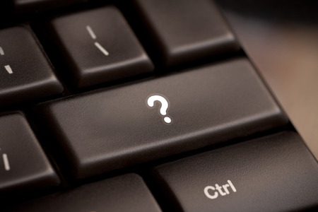 question enter button key on white keyboard photo