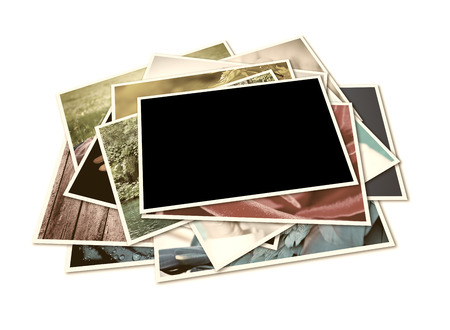 Stack of instant photographs isolated on white  Stock Photo