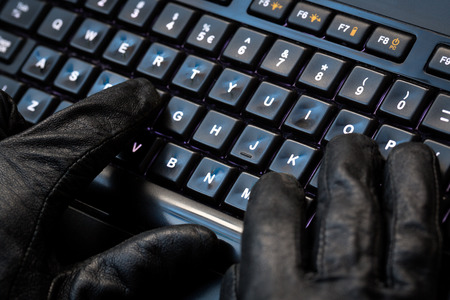 spy ware: Hacker using laptop  Lots of digits on the computer screen