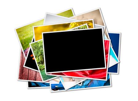 Pile de photographies instantanées isolé sur blanc Banque d'images