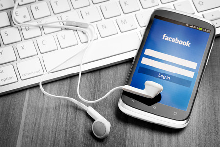 mobile headset: BELCHATOW, POLAND - APRIL 06, 2014: Facebook application on smart phone screen. Editorial