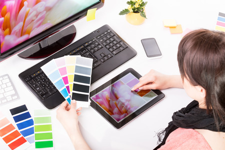 the graphic: Graphic designer at work  Color swatch samples