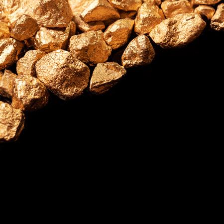 Gold nuggets isolated on black background  photo