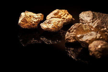 Gold nuggets isolated on black background  photo