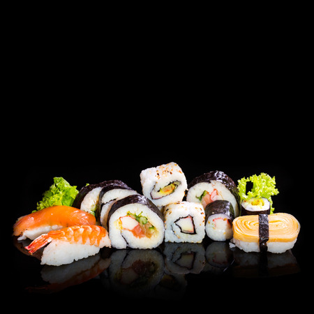 Sushi collection, isolated on black background  photo